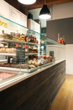 Love the horizontal wood. Commercial remodel - TI of Portland patisserie