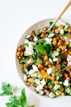Cucumber Tomato Salad with Crispy Chickpeas & Feta | In our column Intuitive Eating with Kale & Caramel, blogger Lily Diamond presents recipes meant to balance the body and inspire the senses.