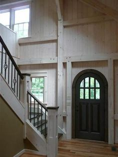 Virginia timber frame home entryway, contrasting round door