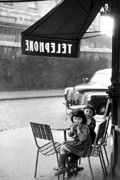www.lurabradbury.com Vintage cuteness in France. Like it because they are eating by a telephone pole