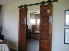 very cool sliding wooden doors between master bedroom and bathroom