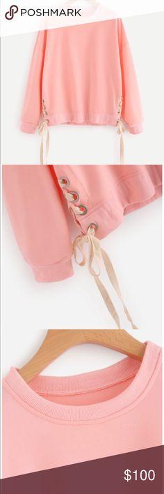 Sweatshirt Pink sweatshirt with cute lace-up on both sides.  Measurements: Shoulder: S:63cm, M:64cm, L:65cm Bust: S:110cm, M:114cm, L:118cm Sleeve Length: S:46cm, M:47cm, L:48cm Length: S:59cm, M:60cm, L:61cm Tops Sweatshirts & Hoodies