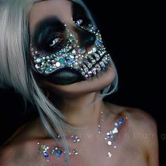 sparkly half skull✨ i was in a brain rut with ideas so when in doubt, make something sparkle!! this will be my last look until after LA IMATS check out my IG stories to see the sparkles in movement!! sooo glittery!! ✨ @thegypsyshrine glitters ✨ @camoeyes manson lenses ✨ @mehronmakeup paradise aq bodypaint in black & white