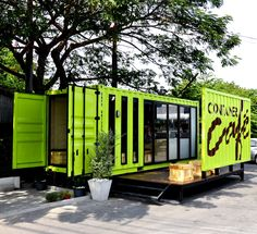 Container Cafe built with shipping containers painted a bright lime green colour Container Bar, Container Store, Shipping Container Cafe, Container Coffee Shop, Shipping Container Conversions, Shipping Container Buildings, Container Restaurant, Used Shipping Containers, Container Architecture