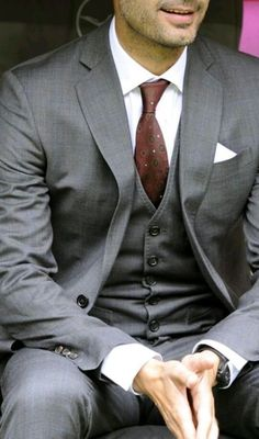 Pairing a grey three piece suit and a white dress shirt will create a powerful and confident silhouette.   Shop this look on Lookastic: https://lookastic.com/men/looks/grey-three-piece-suit-white-dress-shirt-burgundy-tie/17097   — White Dress Shirt  — Burgundy Print Tie  — White Pocket Square  — Grey Three Piece Suit