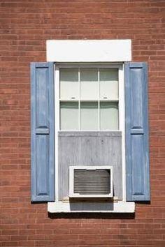 fixing the window unit, blocking the window gap Jupiterimages/Photos.com/Getty Images