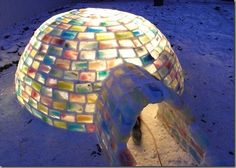 A colored ice igloo made with Hundreds of frozen milk cartons by Daniel Gray and girlfriend Kathleen Starrie