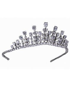 Princess Grace's Van Cleef & Arpels tiara.This diadem was set with round, marquise and pear-shaped diamonds set in platinum, weighing 77.34 carats. Originally a necklace, the tiara was transformed for the occasion of a ball celebrating Princess Caroline's marriage to Philippe Junot in 1978. Today, the tiara belongs to Van Cleef & Arpels' Private Collection.