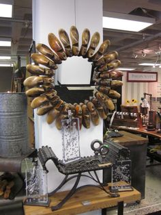 The ultimate in repurposing. This mirror is made from antiques shoe forms