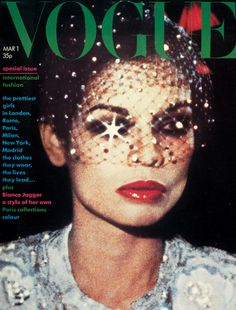 March 1974 International beauty, Bianca Jagger, photographed by Eric Boman: the story of a girl with a style of her own. Make-up by Serge Lutens of Dior. Scent: Dioressence. Rhinestone veil and sequinned fur-trimmed dress by Scherrer