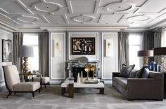 French decorator and architect Jean-Louis Deniot The designer channeled Paris in a Chicago apartment, with custom plaster detailing on the walls and a fireplace of his own design. The bronze-and-parchment coffee table and the Tornado lamps behind the sofa are by Hervé Van der Straeten.