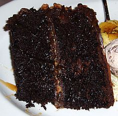 Bake a luscious chocolate fudge cake recipe made with cocoa powder, a box brownie mix and a bourbon recipe with frosting. Chocolate Fudge Cake, Chocolate Desserts, Brownie Cake, Matilda Chocolate Cake, Super Moist Chocolate Cake, Chocolate Frosting, Brownies, Layer Cake Recipes, Dessert Recipes