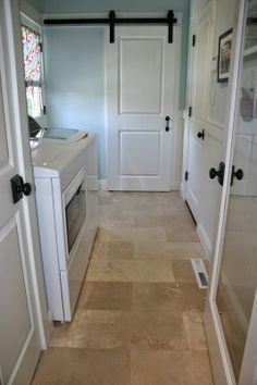 Home is Where the Heart is: Laundry & Powder Room Combo - love this sliding barn door. Would make a great pantry door.