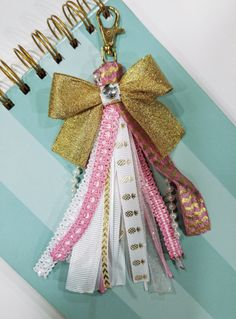 One Gold, Pink and white Ribbon Tassel Keychain The keychain is 4 inches long with the tassel measuring about 2.75 inches and the lobster clasp measuring about 1.25 inches. The tassel is made with various ribbons and gold lobster clasp Please note that color may differ depending on your monitor screen. Custom order are always welcome, please send me a message. Thank you for stopping by and happy shopping