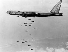 A U.S. B-52 stratofortress drops a load of 750-pounds bombs over a Vietnam coastal area during the Vietnam War, Nov. 5, 1965.