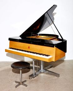 Mid Century Baby Grand Piano by Andreas Christensen in ebonized ash on a stainless steel base