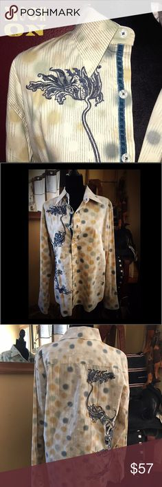 JIMI HENDRIX EXPERIENCE Embroidered shirt Like new JIMI HENDRIX EXPERIENCE Multi-Color Polka Dot Embroidered Shirt   This Jimi Hendrix Experience is in Very Good Condition. Very Stylish and unique embroidered design on the front right back & Jimi's signature embroidered on the  back shoulder. Very cool buttons with criss cross thread. And under the buttons beautiful satin ribbon. There is satin on the inside as well. Beautifully made.  100% Cotton.  2 Extra buttons Included. Tops Button Down…