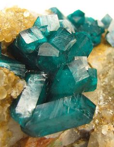 Deep green Dioptase on Quartz | Geology IN