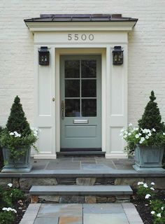 """Design by Loi Thai. Front door is painted Farrow Ball's """"Blue Gray"""" exterior is painted in Benjamin Design by Loi Thai. Front door is painted Farrow Ball's """"Blue Gray"""" exterior is painted in Benjamin Moore Linen White. The Doors, Entrance Doors, Door Entry, House Entrance, Entry Stairs, Portico Entry, Small Entrance, Entryway, Entrance Ideas"""