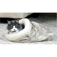 The Kitty Crinkle Sack is a fun place to hide, peek or just take a nap.