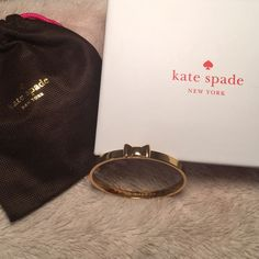 "Kate Spade Take A Bow Gold Bangle NWOT Gold Kate Spade bangle with bow. In perfect condition- never worn before! New without tags. Inside clarifies authenticity with ""Kate Spade New York"" engraved. Comes with box & dust bag as pictured. kate spade Jewelry Bracelets"