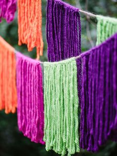 Hang a colorful banner (made of yarn) with clothespins and tie to trees, deck or patio.