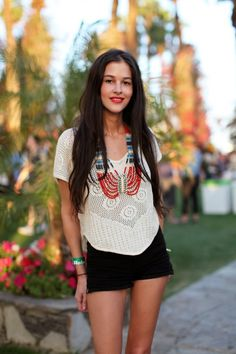 Black shorts, long hair and a great necklace. Not really rock but definitely California.