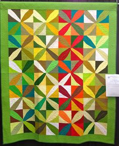 Love the solids with gorgeous quilting, seen on quiltshare209.blogspot.com
