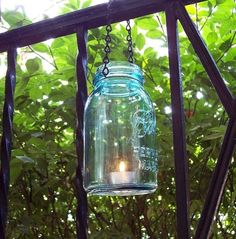 Hanging mason jar candle holder.  Makes me long for a patio…