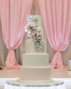 Blush pink pearl lustre sugar roses and peonies cascade wedding cake