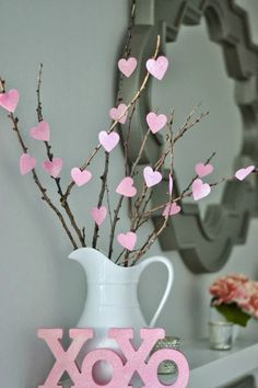DIY $1 Heart Tree: Can you believe that this centerpiece only cost one dollar to create?! Click through to find more DIY Valentine's Day decorations for your home.