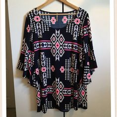 """Emma Rose Black, White & Neon Pink Tribal Tunic Emma Rose Black, White & Neon Pink Tribal Tunic. Great shape! Stretchy polyester. Gypsy sleeves. So comfy and drapey. Wear as dress or as a top. Bust 42"""", hips 46"""", length 31"""". #boho, #soho, #gypsy, #coachella, #aztec, #indian Emma Rose Dresses Mini"""