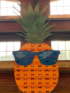 Probably the biggest pineapple you'll ever see! This custom made pineapple was created to be a giveaway station to hold sunglasses for the lucky winners on this Carnival Cruise Line.