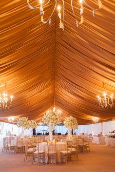 gold tent + romantic lighting + chandeliers + sky high flowers @ivyrobinson @corbin