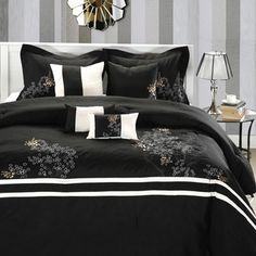 @Overstock - The Park Avenue Comforter Set features Asian-inspired poppy flower in gold embroidery atop a black background. This set is further enhanced by white contrast on the comforter and decorative pillows.http://www.overstock.com/Bedding-Bath/Park-Avenue-Black-white-8-piece-Comforter-Set/6707269/product.html?CID=214117 $89.99