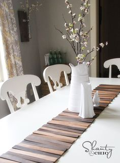 DIY Table Runner, though I think this would be great on the back wall of a shelf, maybe in a glass cabinet where dust is minimized.