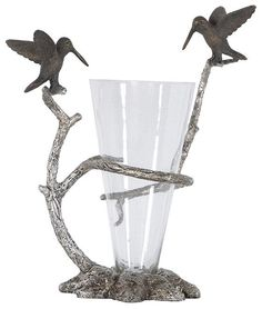 A vase is a great table centerpiece for any room. HomeDecorators.com