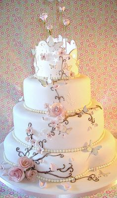 So whimsy and beautiful! I would leave off the roses on the very top. Wedding cake ~