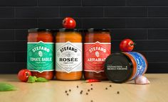 Brand identity and packaging for Stefano Faita and Michele Forgione's first line of ready-to-serve grocery products. Shelves have been stocked with four varieties of canned tomato sauce (Tomato and Basil, Marinara, Arrabiata and Rosée) featuring an eye-ca…