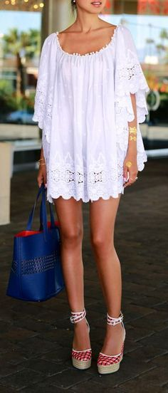 Summer trends | White crochet bohemian mini dress, blue handbag, heels---Personally, I would not wear it without bike shorts---at least. And ditch the heels for flat sandals