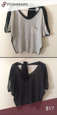 Polka dot blouse with bow on back Polka dot blouse with bow on back . ◾️size small ◾️pocket on front ◾️cotton fabric in front , chiffon/ sheet for black back with bow. Tops