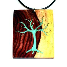 Muladhara Tree (two-tone Rosewood with crushed turquoise inlay). By Dharma Wanderlust. Handcrafted yoga-inspired wooden boho jewellery. Wooden jewelry handmade in Ontario, Canada. Gorgeous. Unique. One of a kind!