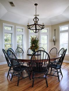 Dining Room Ideas- I actually REALLY love the idea of a giant round table. So cool!