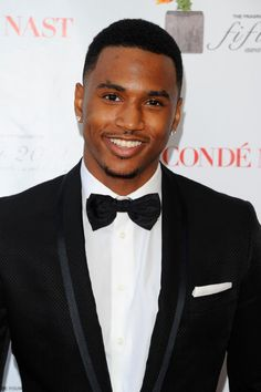 Besides being extremely sexy..... (: Trey Songz's voice is sooo powerful and his lyrics would make any girl fall in love with him. Did I mention he is GORGEOUS?! Yes, that too :D