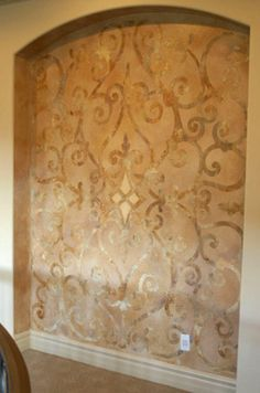 An elegant stenciled niche with a Modello Designs customized Architectural Panel masking stencil by @Patty Markison Markison Markison Markison Markison Henning of Fabulous Finishes.