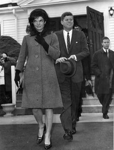 PX70-20:173 24 November 1962 President and Mrs. Kennedy exit St. Francis Xavier Church in Hyannis after attending mass, 25 November 1962. Copyright New Bedford Standard Times in the John F. Kennedy Presidential Library and Museum, Boston. Scanned from original file print.