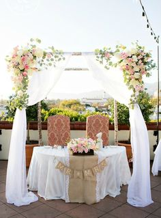 Gorgeous Santa Barbara wedding reception at Kimpton Canary Hotel. The sweetheart table for the new Mr. and Mrs. featured their re-purposed wooden and floral arbor from the wedding ceremony. Perfection!