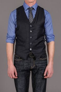 a man in a vest,,,I am a huge fan of vests and am working on my collection, as well as ties