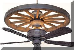 A Rustic Lighting and Fans exclusive! The Copper Canyon Cheyenne Wagon Wheel Ceiling Fan feature a molded and hand painted resin wagon wheel replica. Western Decor, Country Decor, Rustic Decor, Western Style, Western Bar, Wagon Wheel Light, Wagon Wheel Decor, Wagon Wheel Chandelier, Western Kitchen