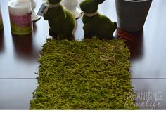 """cheaper than buying rolls of """"moss fabric"""" and easy - just cardboard, spray adhesive, and loose faux moss (can get bags of at michaels/joanns)"""